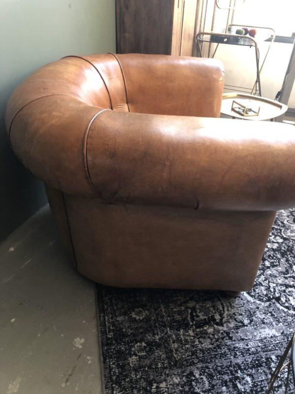 Halfronde schaapslederen bruine armfauteuil