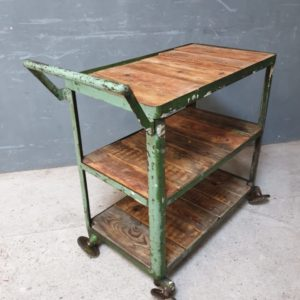 Industrial factory trolley with wooden shelves on wheels