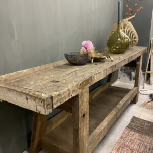 Old long robust wooden workbench with storage space