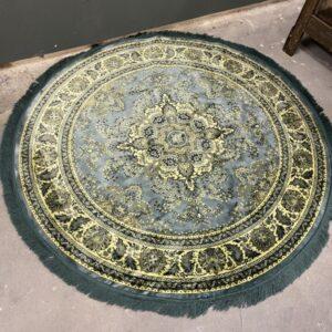 Ronde groene tapijt, vintagelook